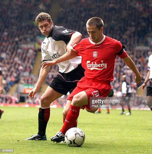 Liverpool's Michael Owen is tackled by Fulhams Moritz Voltz during Premiership clash at Anfield Liverpool United Kingdom 17 April 2004 AFP PHOTO/...