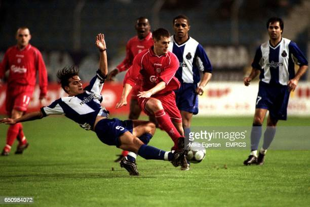 Liverpool's Michael Owen is tackled by Porto's Paredes