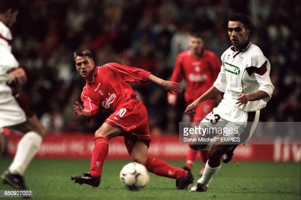 Liverpool's Michael Owen plays a defence splitting ball past Rapid Bucharest's Michai Iencsi