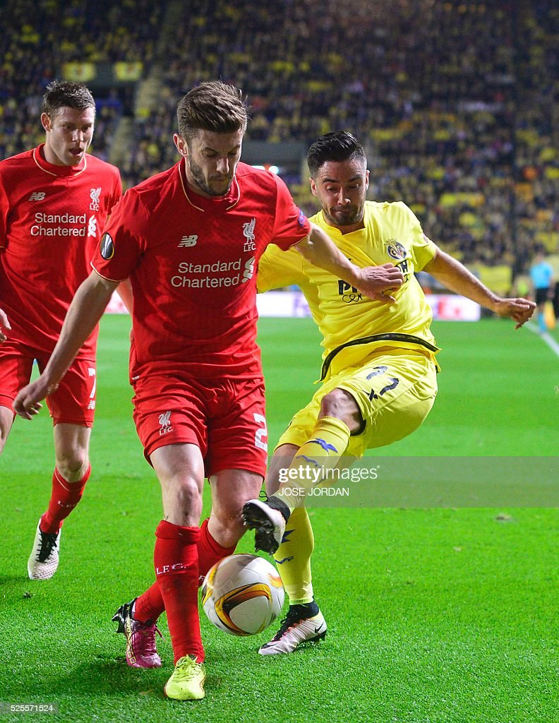 Liverpool's midfielder Adam Lallana (L) vies with Villarreal's midfielder Jaume Costa during the UEFA Europa League semifinals first leg football match Villarreal CF vs Liverpool FC at El Madrigal stadium in Vila-real on April 28, 2016. / AFP / JOSE