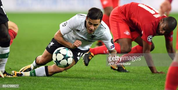 Liverpool's midfielder from Brazil Philippe Coutinho Correia and Spartak Moscow's midfielder from Brazil Fernando vie for the ball during the UEFA...