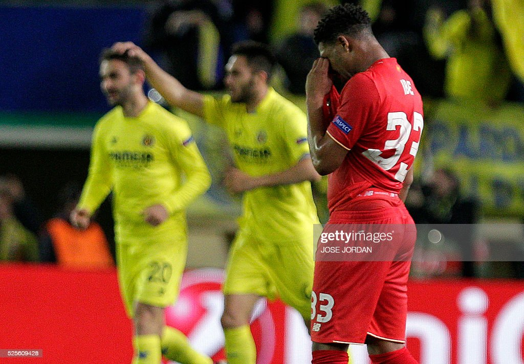 Liverpool's midfielder Jordon Ibe (R) gestures at the end of the UEFA Europa League semifinals first leg football match Villarreal CF vs Liverpool FC at El Madrigal stadium in Vila-real on April 28, 2016. / AFP / JOSE