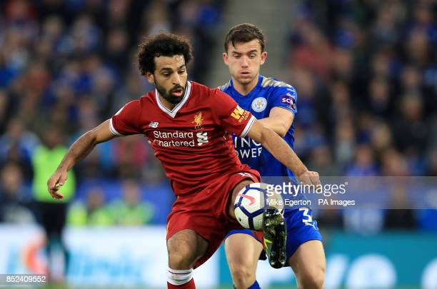 Liverpool's Mohamed Salah and Leicester City's Ben Chillwell battle for the ball during the Premier League match at King Power Stadium Leicester