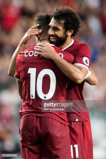Liverpool's Mohamed Salah celebrates a goal with teammate Philippe Coutinho during the final of the Premier League Asia Trophy football tournament...