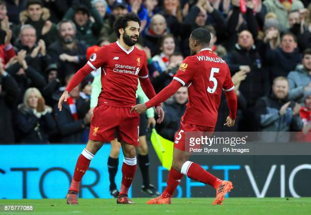 Liverpool's Mohamed Salah celebrates scoring his side's first goal of the game with team mate Liverpool's Georginio Wijnaldum during the Premier...