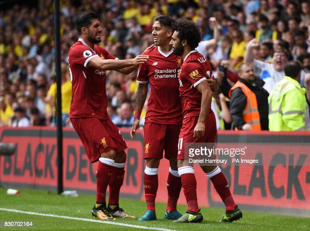Liverpool's Mohamed Salah celebrates scoring his side's third goal with teammates Emre Can and Roberto Firmino during the Premier League match at...