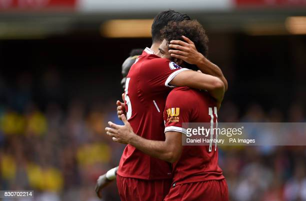 Liverpool's Mohamed Salah celebrates scoring his side's third goal with teammate Emre Can during the Premier League match at Vicarage Road Watford