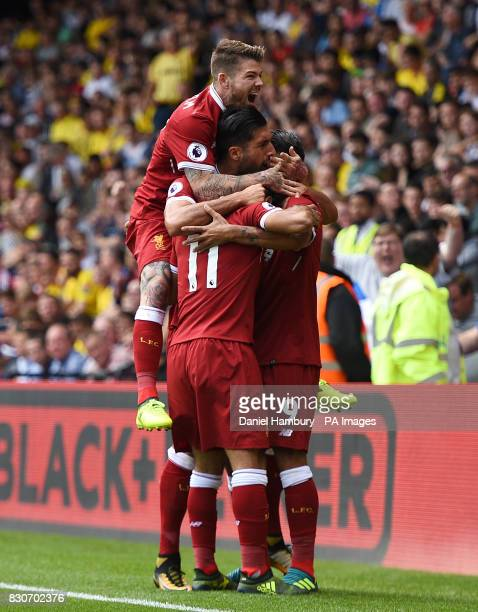 Liverpool's Mohamed Salah celebrates scoring his side's third goal with teammates Alberto Moreno Emre Can and Roberto Firmino during the Premier...