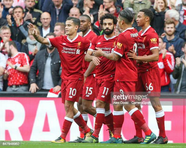 Liverpool's Mohamed Salah celebrates scoring the equalising goal with teammates during the Premier League match between Liverpool and Burnley at...