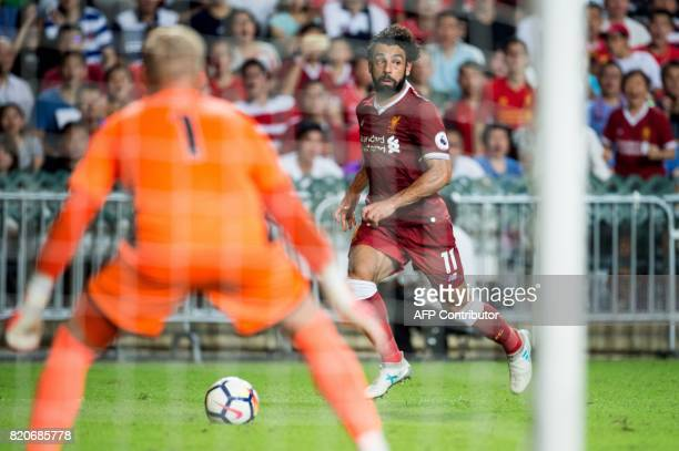 Liverpool's Mohamed Salah controls the ball during the final of the Premier League Asia Trophy football tournament between Liverpool and Leicester...