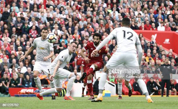 Liverpool's Mohamed Salah fails to hit the target with a chipped effort on goal during the Premier League match between Liverpool and Manchester...