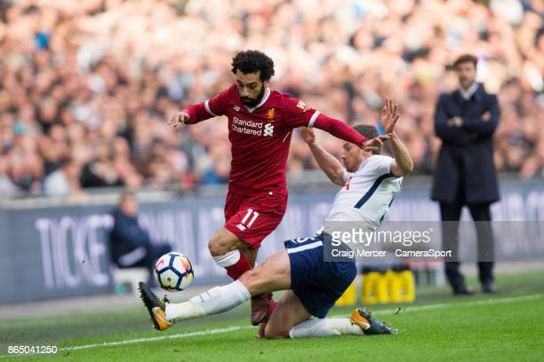 Liverpool's Mohamed Salah is tackled by Tottenham Hotspur's Jan Vertonghen during the Premier League match between Tottenham Hotspur and Liverpool at...