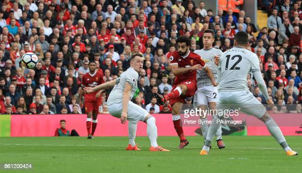 Liverpool's Mohamed Salah shoots during the Premier League match at Anfield Liverpool