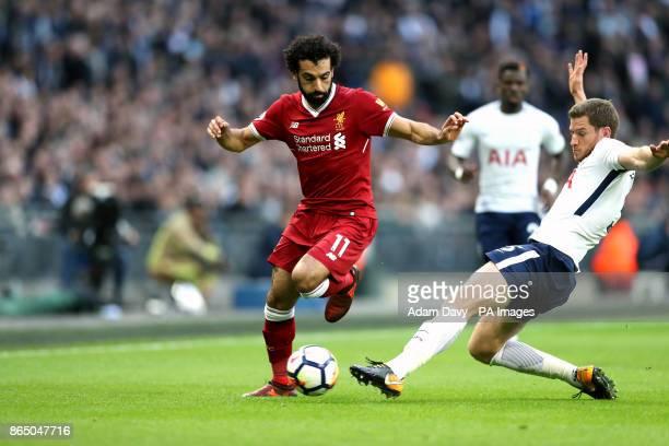 Liverpool's Mohamed Salah Tottenham Hotspur's Jan Vertonghen battle for the ball during the Premier League match at the Wembley Stadium London
