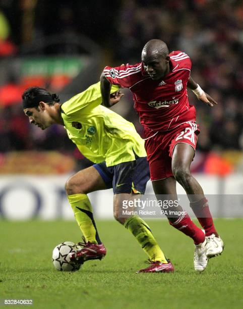Liverpool's Mohamed Sissoko and Barcelona's Rafael Marquez battle for the ball