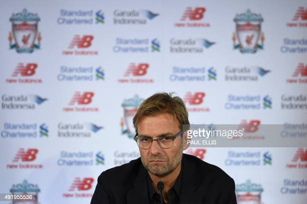 Liverpool's new German manager Jurgen Klopp speaks at a press conference to announce his new appointment at Anfield in Liverpool northwest England on...