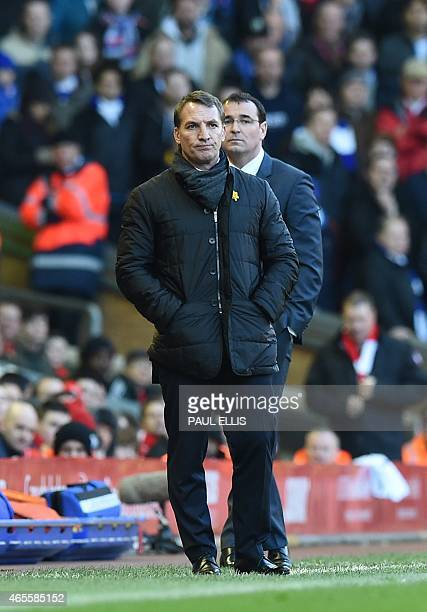 Liverpool's Northern Irish manager Brendan Rodgers and Blackburn's English manager Gary Bowyer look on during FA Cup quarterfinal match between...