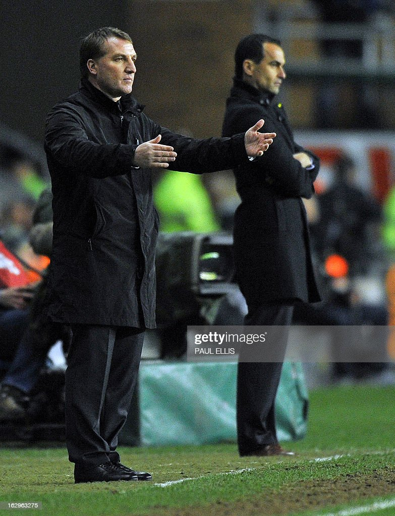 Liverpool's Northern Irish manager Brendan Rodgers (L) gestures beside Wigan Athletic's Spanish manager Roberto Martinez (R) during the English Premier League football match between Wigan Athletic and Liverpool at The DW Stadium in Wigan, northwest England, on March 2, 2013. USE. No use with unauthorized audio, video, data, fixture lists, club/league logos or 'live' services. Online in-match use limited to 45 images, no video emulation. No use in betting, games or single club/league/player publications.