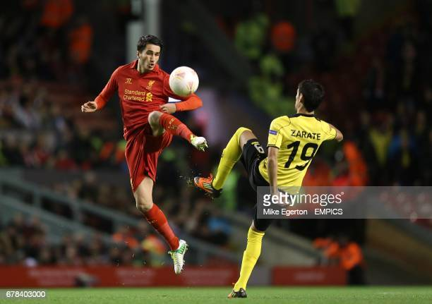 Liverpool's Nuri Sahin and Young Boys' Gonzalo Zarate battle for the ball