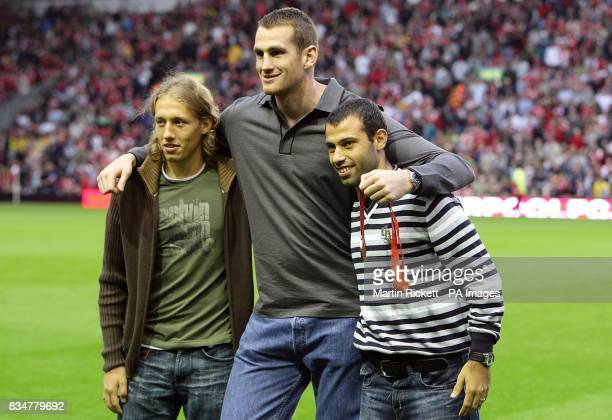 Liverpool's Olympic Medal winners Leiva Lucas and Javier Mascherano stand with Boxing Super Heavyweight Bronze Medalist David Price prior to kick off