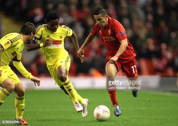 Liverpool's Oussama Assaidi runs at Anzhi Makhachkala's Kamil Agalarov and Samuel Eto'o
