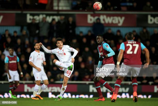 Liverpool's Pedro Chirivella and West Ham United's Cheikhou Kouyate in action during the Emirates FA Cup fourth round replay match at Upton Park...