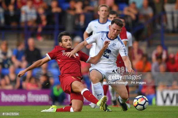 Liverpool's Pedro Chirivella battles for the ball during the preseason friendly at Prenton Park Tranmere