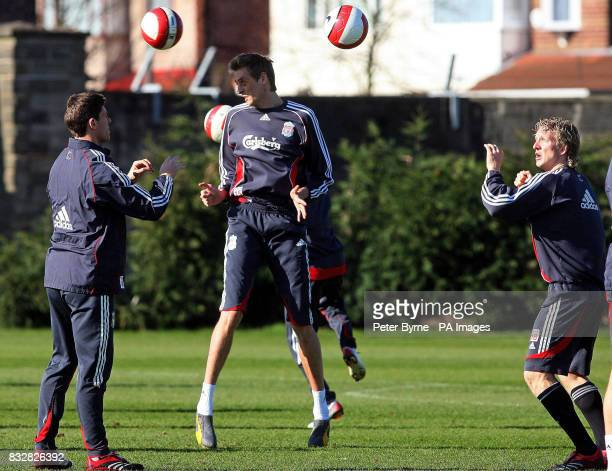 Liverpool's Peter Crouch Xabi Alonso and Dirk Kuyt during a training session at Melwood Training Complex Liverpool
