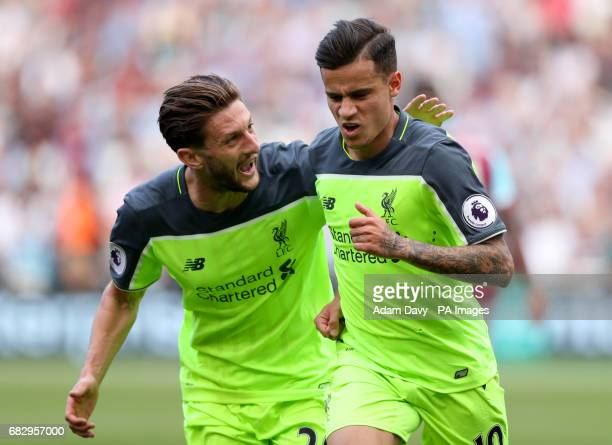 Liverpool's Philippe Coutinho celebrates scoring his side's third goal of the game with team mate Adam Lallana during the Premier League match at...