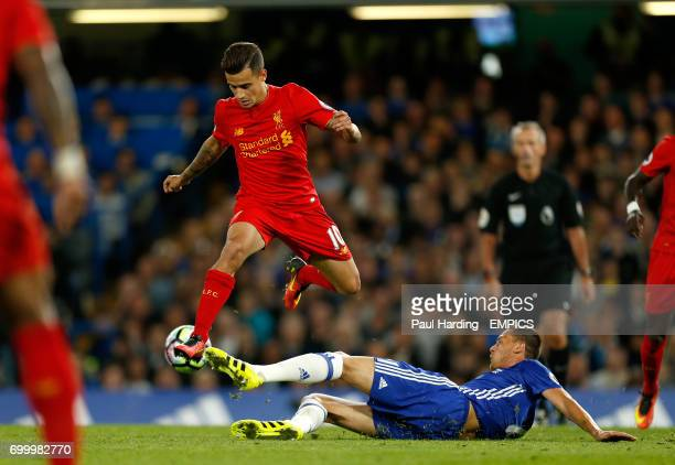 Liverpool's Philippe Coutinho hurdles a challenge from Chelsea's Nemanja Matic
