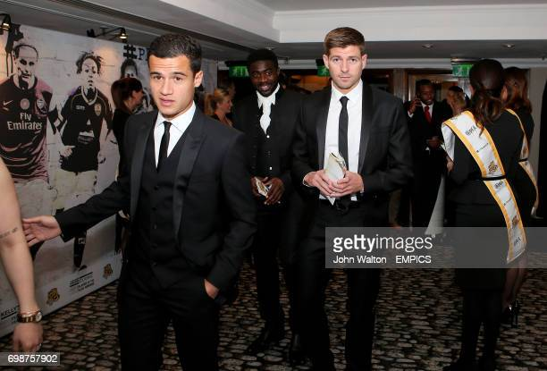 Liverpool's Philippe Coutinho Kolo Toure and Steven Gerrard during the PFA Player of the Year Awards 2015 at the Grosvenor House Hotel London