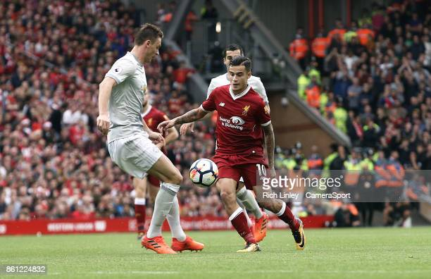 Liverpool's Philippe Coutinho looks to go past Manchester United's Nemanja Matic during the Premier League match between Liverpool and Manchester...