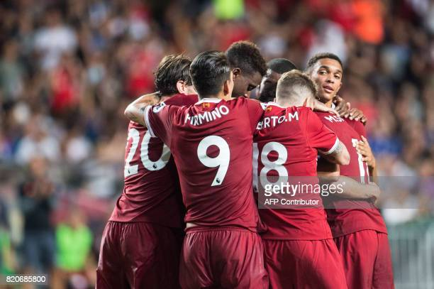 Liverpool's players celebrate a goal during the final of the Premier League Asia Trophy football tournament between Liverpool and Leicester City in...