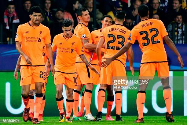 Liverpool's players celebrate at the end of the UEFA Champions League group E football match between NK Maribor and Liverpool at the Ljudski vrt...