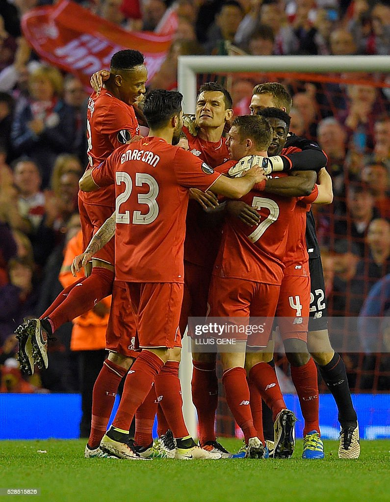 Liverpool's players celebrate at the final whistle after a 3-0 victory during the UEFA Europa League semi-final second leg football match between Liverpool and Villarreal CF at Anfield in Liverpool, northwest England on May 5, 2016. / AFP / LLUIS