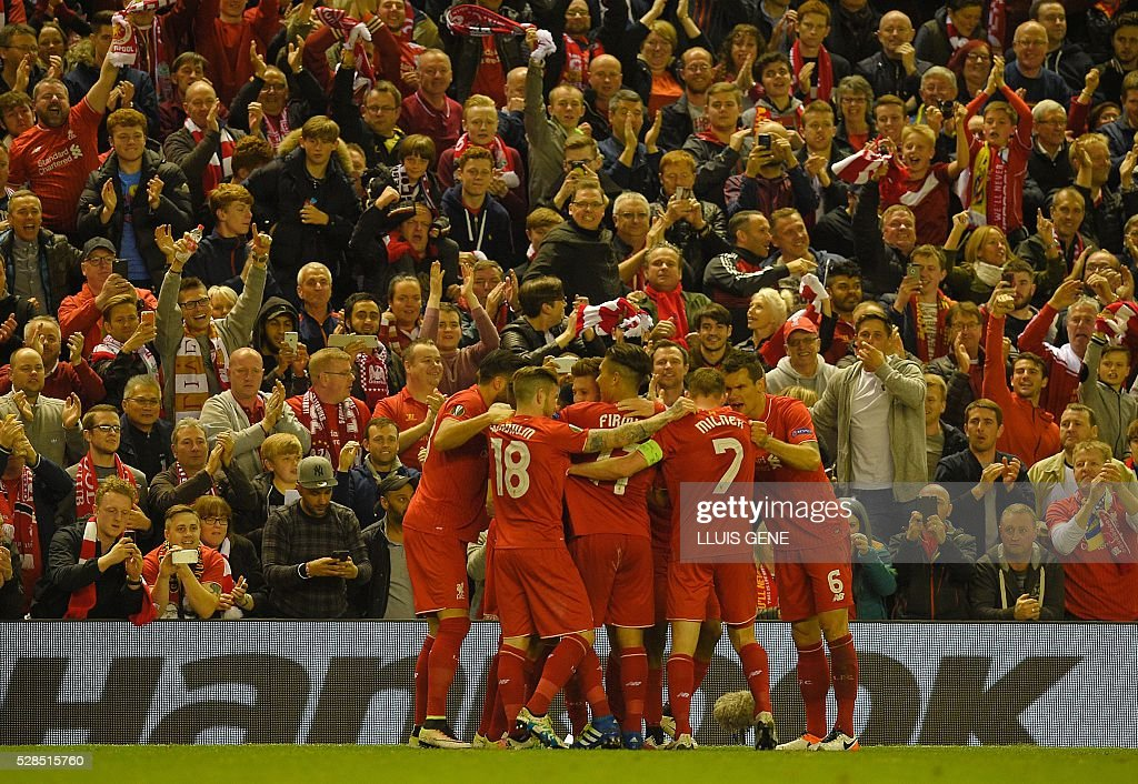 Liverpool's players celebrate the goal by Liverpool's English striker Daniel Sturridge during the UEFA Europa League semi-final second leg football match between Liverpool and Villarreal CF at Anfield in Liverpool, northwest England on May 5, 2016. / AFP / LLUIS