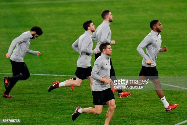 Liverpool's players run during a training session at Ramon Sanchez Pizjuan stadium in Sevilla on November 20 2017 on the eve of the UEFA Champions...