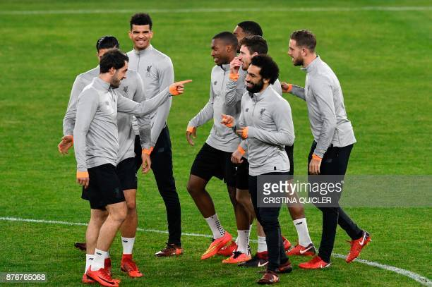 Liverpool's players take part in a training session at Ramon Sanchez Pizjuan stadium in Sevilla on November 20 2017 on the eve of the UEFA Champions...