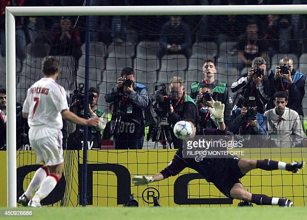 Liverpool's Polish goalkeeper Jerzy Dudek saves a penalty kick by AC Milan's Ukrainian forward Andriy Shevchenko to win the UEFA Champions league...