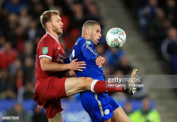 Liverpool's Ragnar Klavan and Leicester City's Islam Slimani battle for the ball during the Carabao Cup third round match at the King Power Stadium...