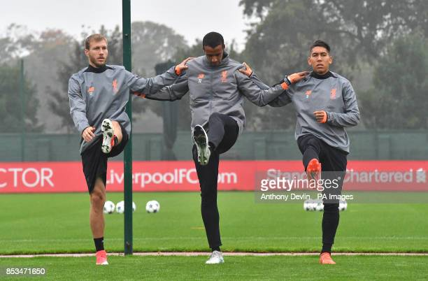 Liverpool's Ragnar Klavan Joel Matip and Roberto Firmino during the training session at Melwood Liverpool