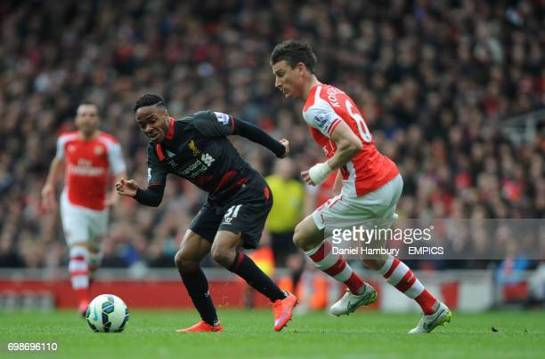 Liverpool's Raheem Sterling and Arsenal's Laurent Koscielny battle for the ball