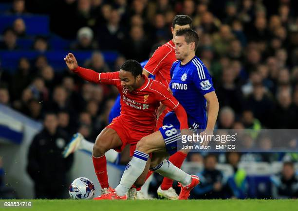 Liverpool's Raheem Sterling and Chelsea's Cesar Azpilicueta battle for the ball
