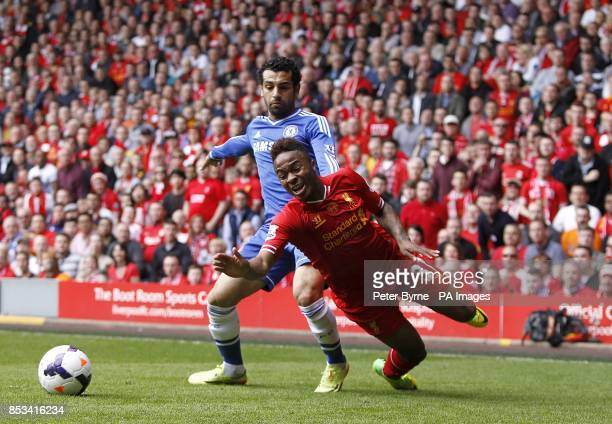 Liverpool's Raheem Sterling is fouled by Chelsea's Mohamed Salah