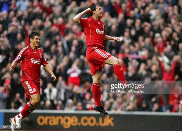 Liverpool's Robbie Fowler jumps in the air to celebrate scoring the first goal of the game with team mate Mark Gonzalez