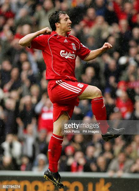 Liverpool's Robbie Fowler jumps in the air to celebrate scoring the first goal of the game