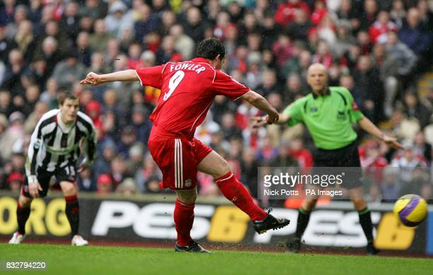 Liverpool's Robbie Fowler scores the first goal of the match from the penalty spot