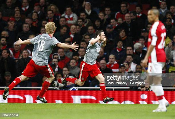 Liverpool's Robbie Keane celebrates scoring his sides first goal of the game as Arsenal's gael Clichy stands dejected