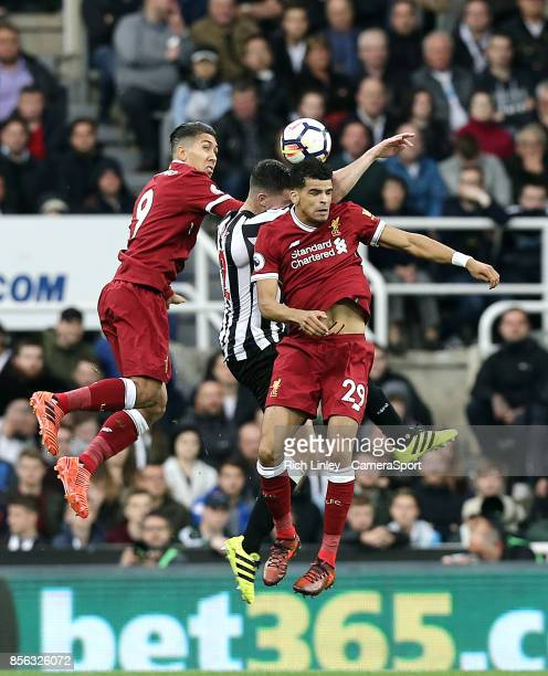 TYNE ENGLAND OCTOBER Liverpool's Roberto Firmino and Dominic Solanke battle with Newcastle United's Ciaran Clark during the Premier League match...