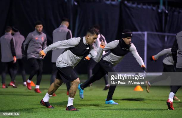 Liverpool's Roberto Firmino and Dominic Solanke during a training session at Melwood Training Ground Liverpool